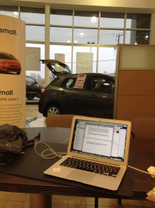 """The view from my """"office"""" at the Toyota dealer, getting on my snow tires!"""